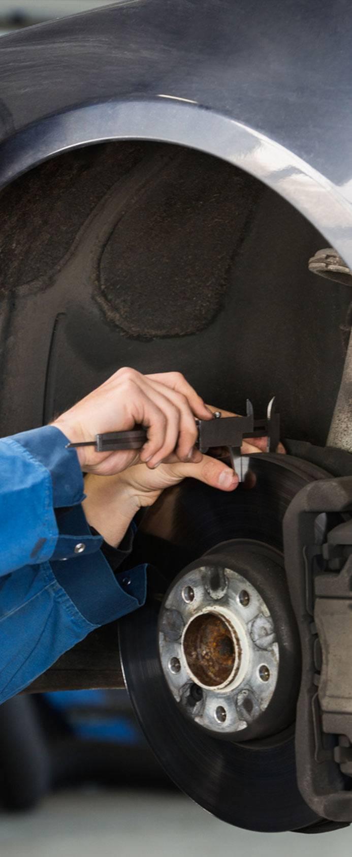 mechanic measuring car brakes